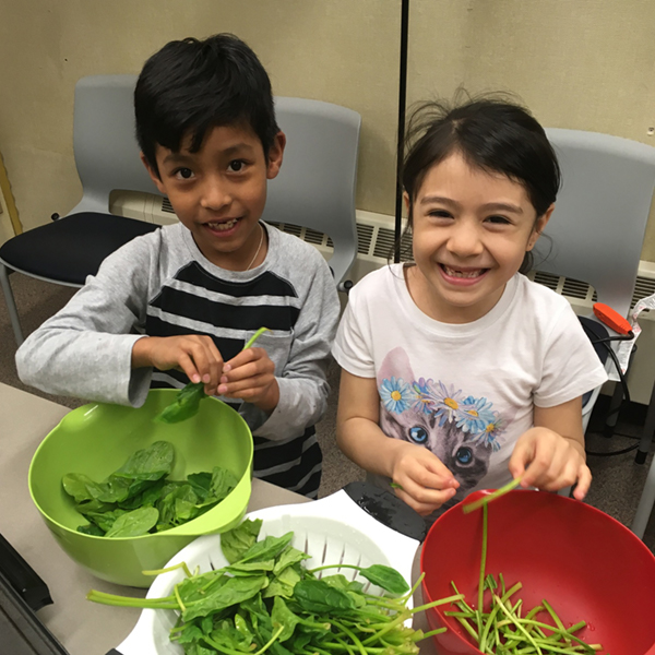 cooking matters participants smiling with food