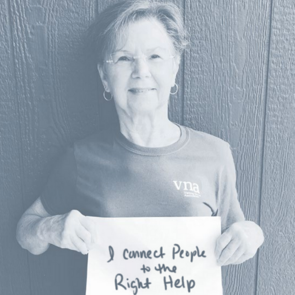 VNA team member with sign