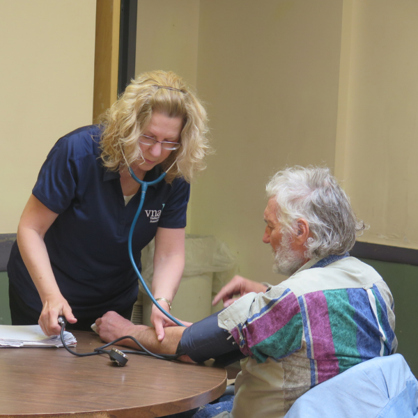 shelter nurse taking care of homeless patient